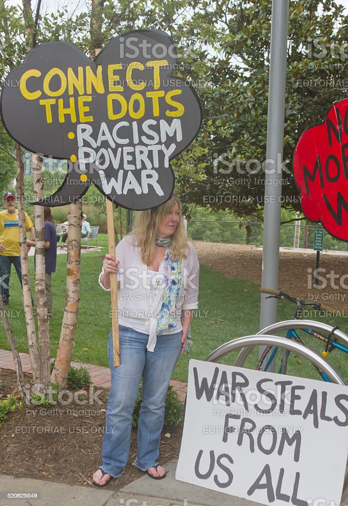 Racism, Poverty and War Protest at a Moral Monday Rally stock photo
