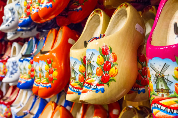 rack in the store with rows traditional dutch wooden shoes - klompen (clogs) - netherlands stock pictures, royalty-free photos & images