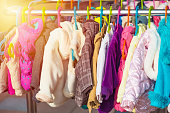 Rack of baby and children jackets displayed at outdoor hanger market for sale
