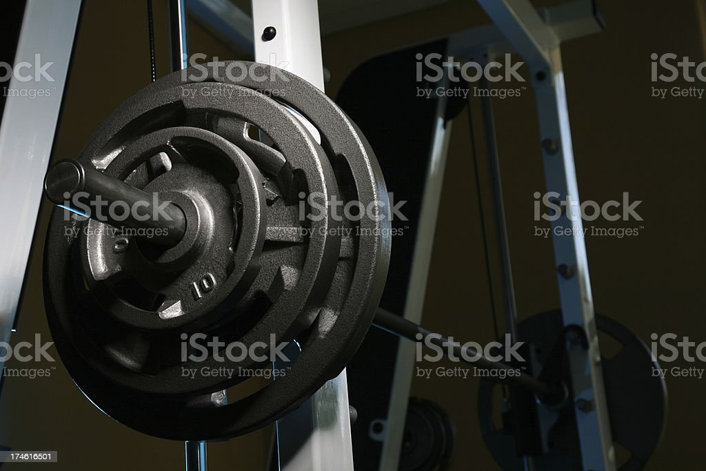 Rack of Barbell Weights in Gym on Bench Press Machine stock photo