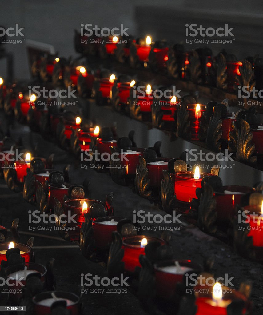 rack of candles in church stock photo