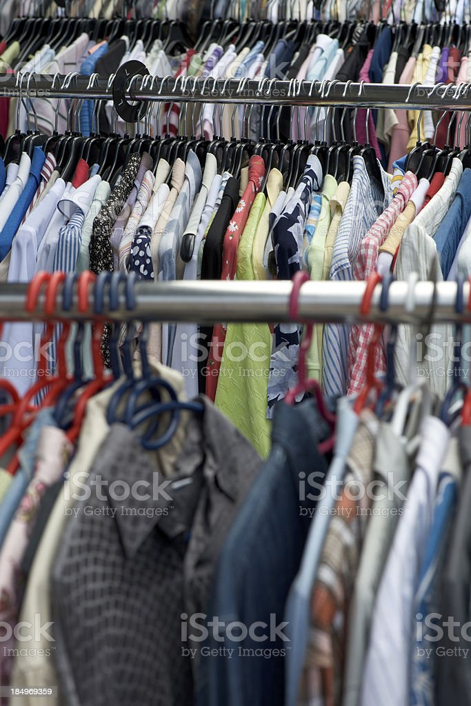 Rack of clothes at flea market stock photo
