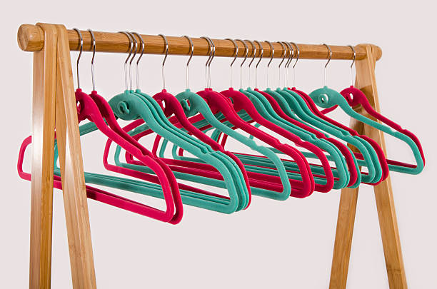 Rack of clothes with empty hangers. stock photo