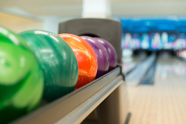 Rack Of Colorful Balls At A Bowling Alley stock photo