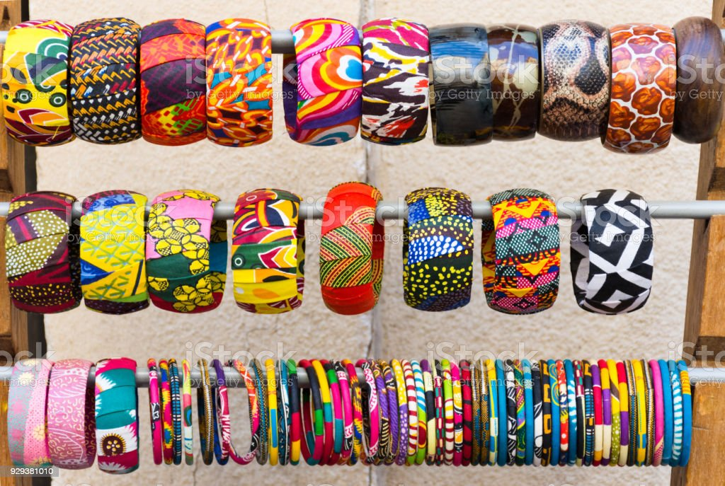 A Rack of Colorful Bangles for Sale stock photo