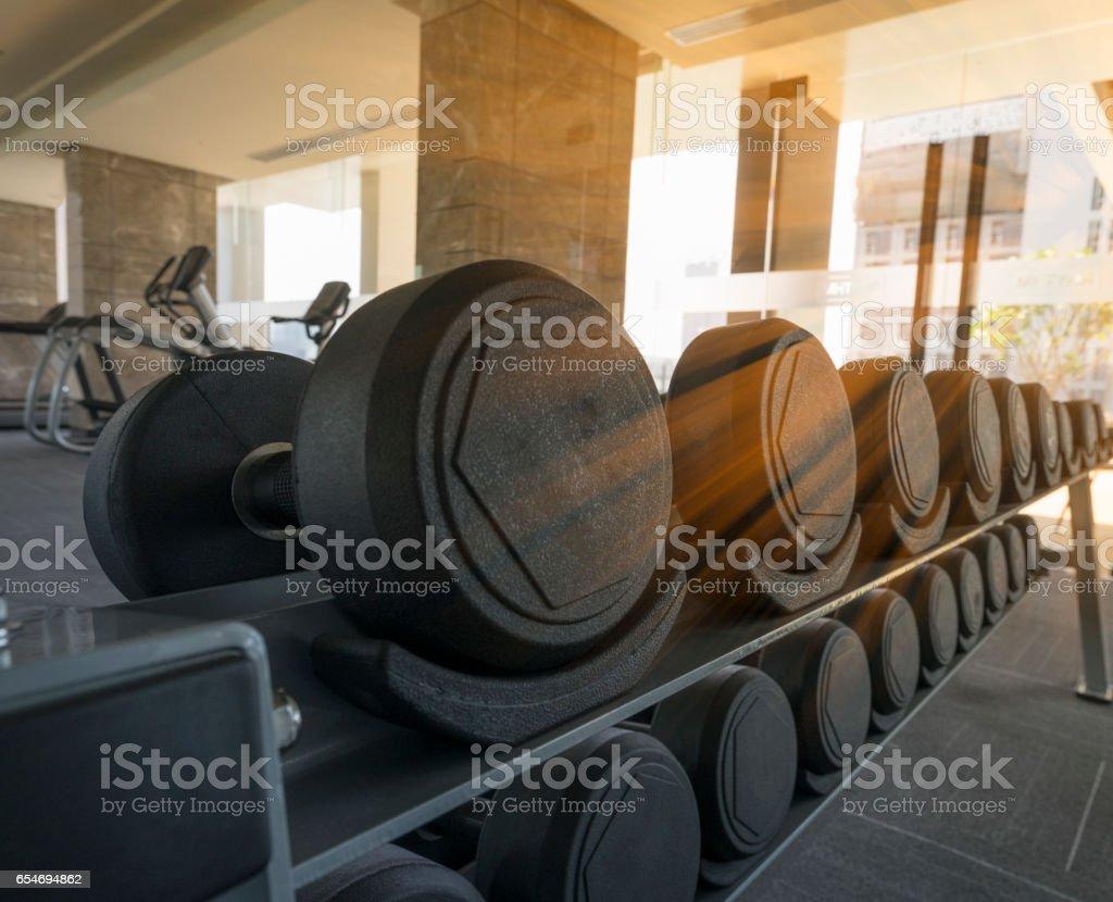 Rack of dumbbell in  the morning stock photo