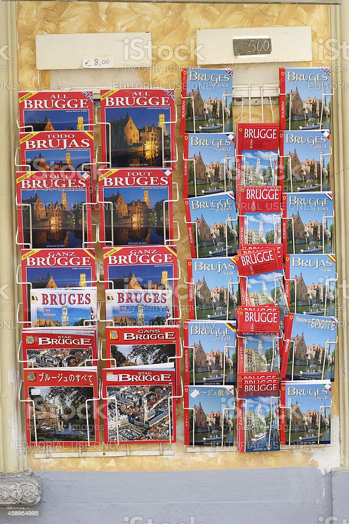 Rack of guide books and maps in Bruges, Belgium royalty-free stock photo