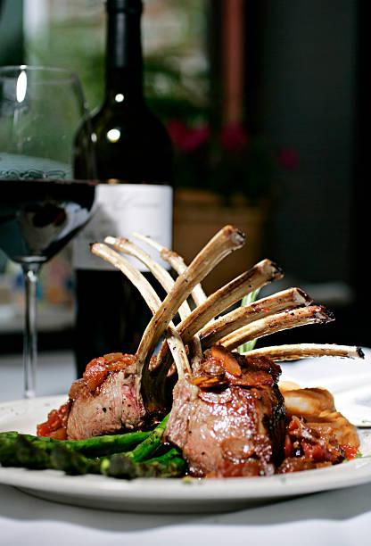 Rack of Lamb and wine stock photo