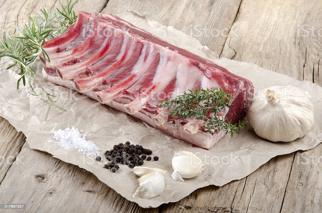 rack of lamb on brown paper stock photo