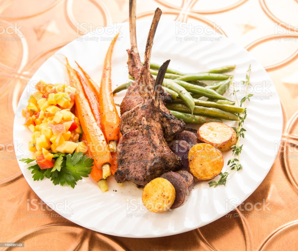 Rack of Lamb with Carrots and Green Beans stock photo