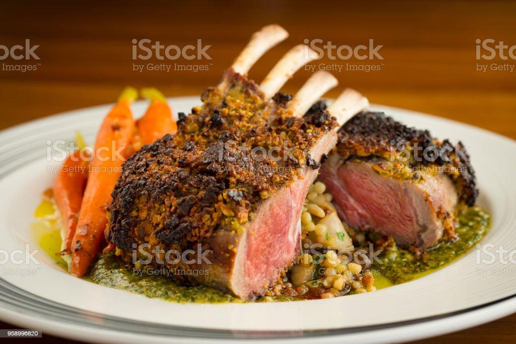 Rack of lamb with carrots Smalll rack of lamb with carrots and nice sauce, medium rare Bone Stock Photo