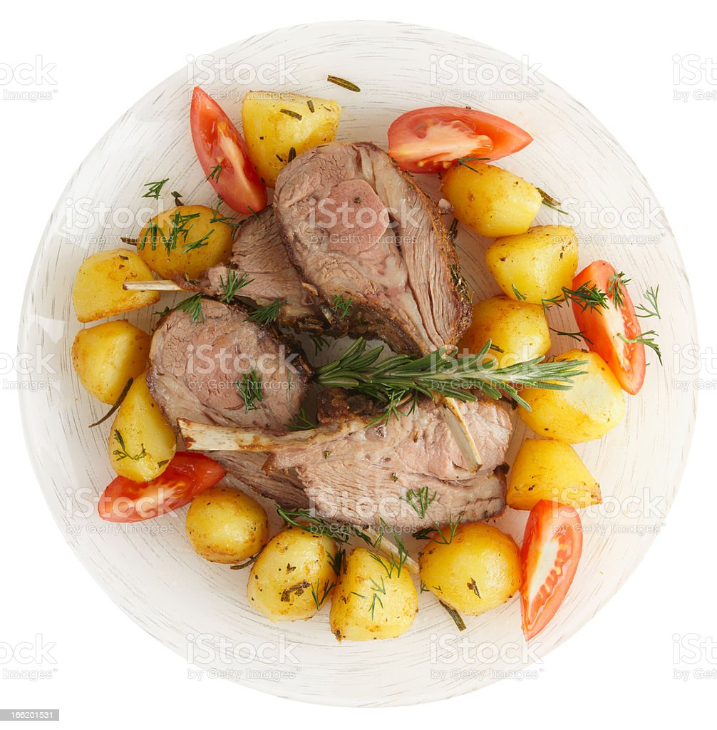 Rack of lamb with fried potatoes isolated on white stock photo
