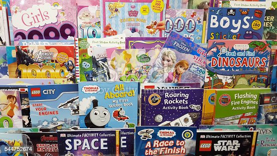 A rack of children's books covering a variety of subjects and interests.