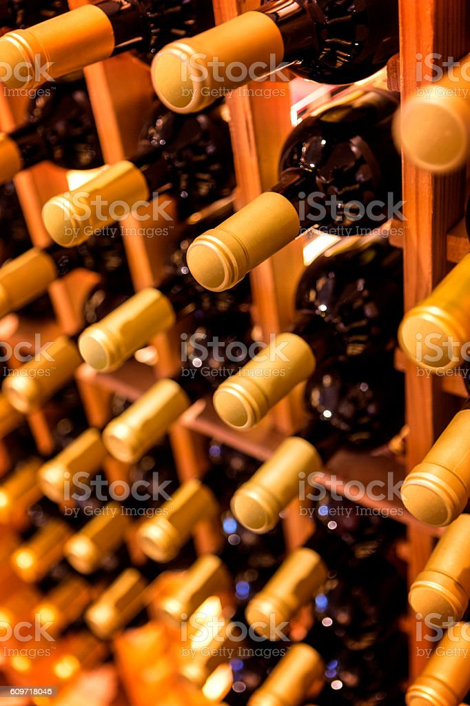 Rack of wine bottles stock photo