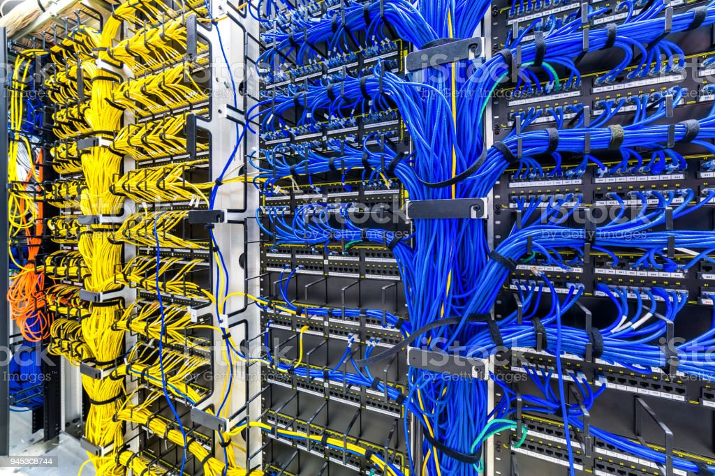 Rack with generic Ethernet cat5e cables stock photo