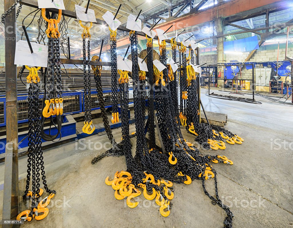 Rack with new cargo chain slings. stock photo