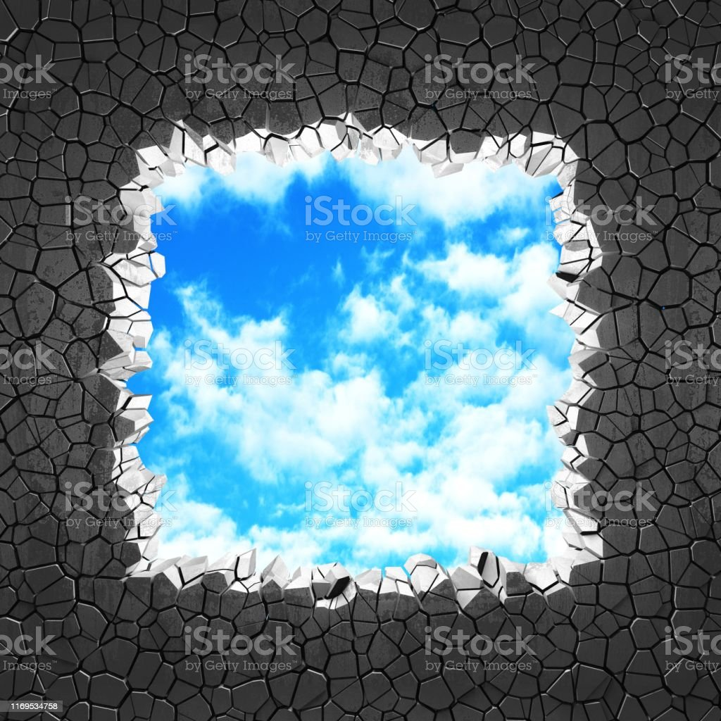 Сracked broken hole in concrete wall to cloudy sky. Freedom concept....