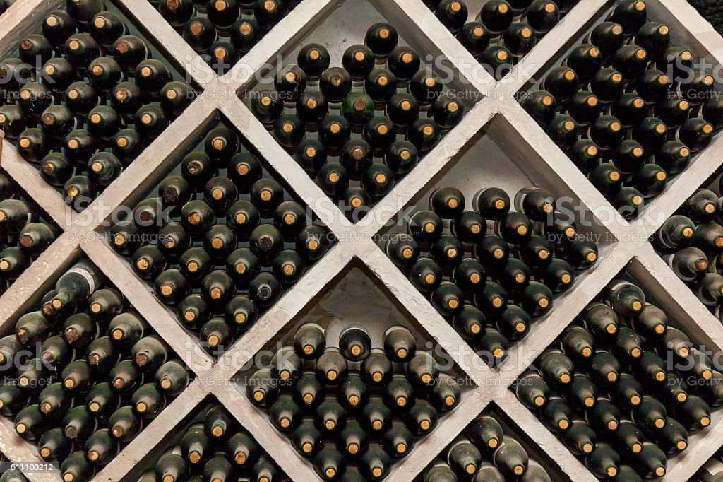 Racks of wine bottles stock photo