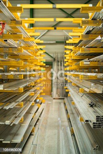 istock racks with aluminium prfiles in warehouse 1054963026