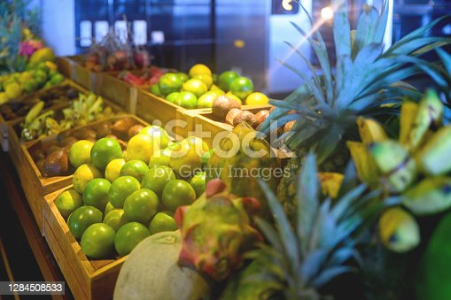 Racks with fruit in grocery store