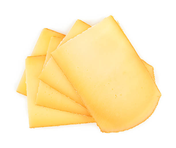 raclette de fromage isolé sur fond blanc - raclette photos et images de collection