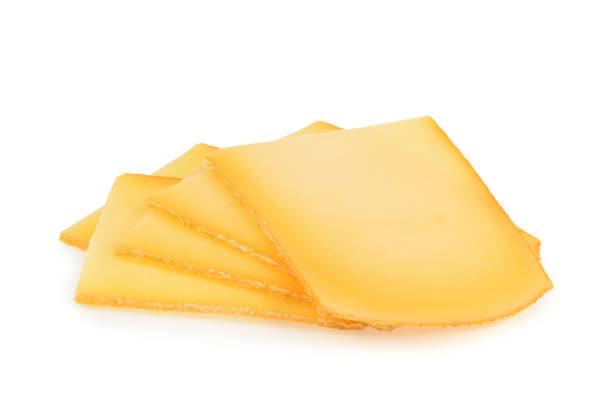 raclette cheese isolated on white background - raclettekäse stock-fotos und bilder