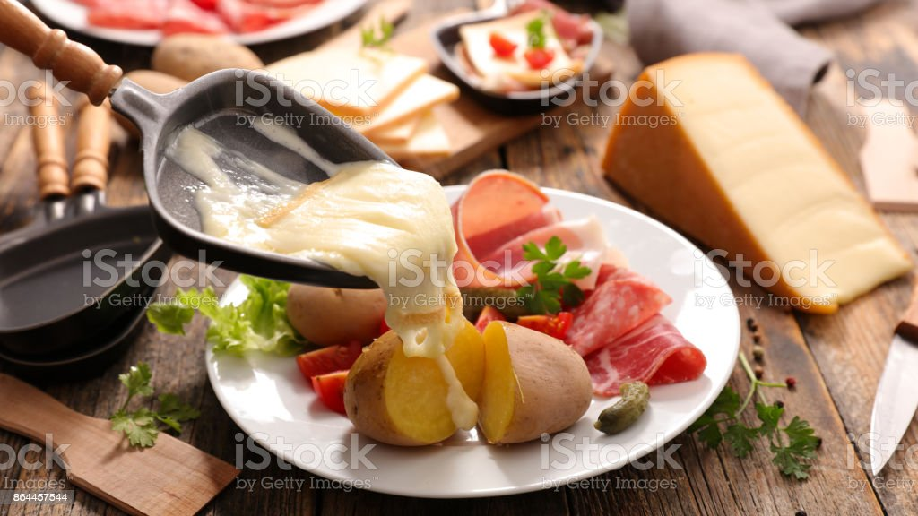 raclette cheese melted stock photo