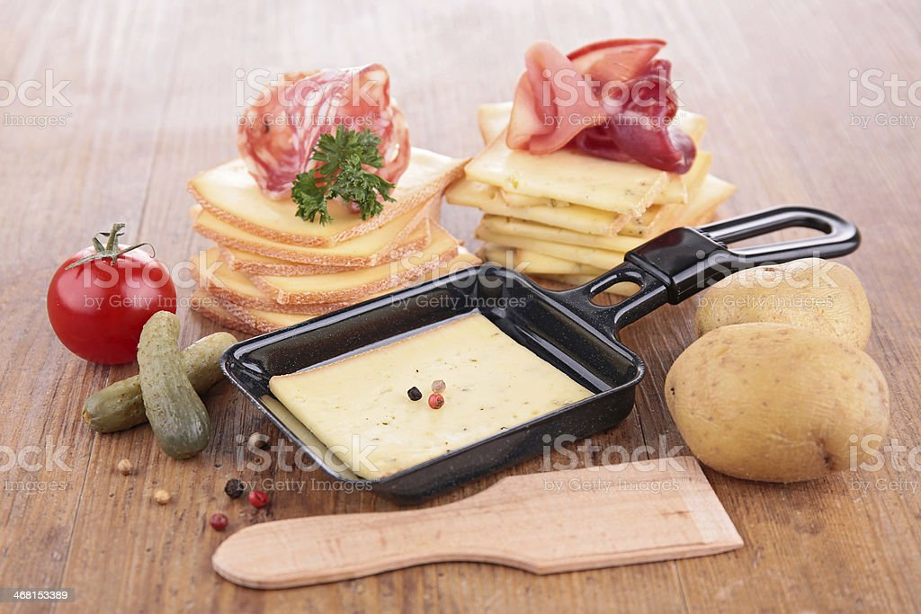 raclette on wood background stock photo