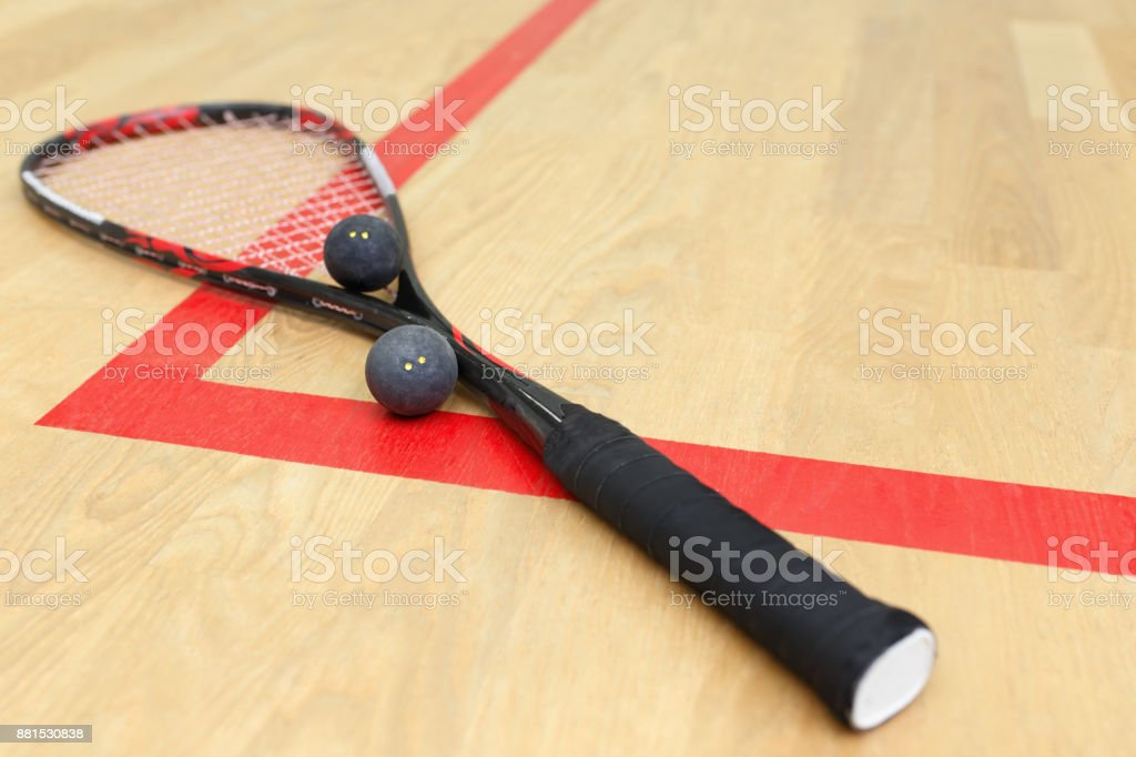 racquetball equipment on the court stock photo