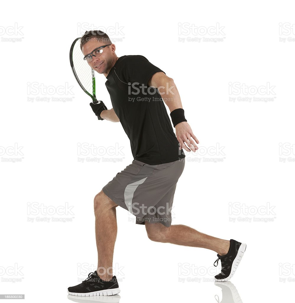 Racquetball player in action stock photo