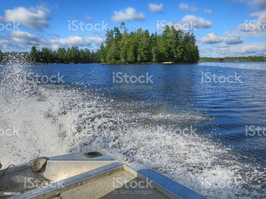 Racquette Lake, Tree Lined Island, New York Adirondacks, Bassboat Wake stock photo