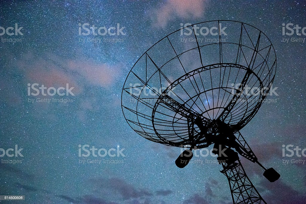 radar dish against cloud sky stock photo