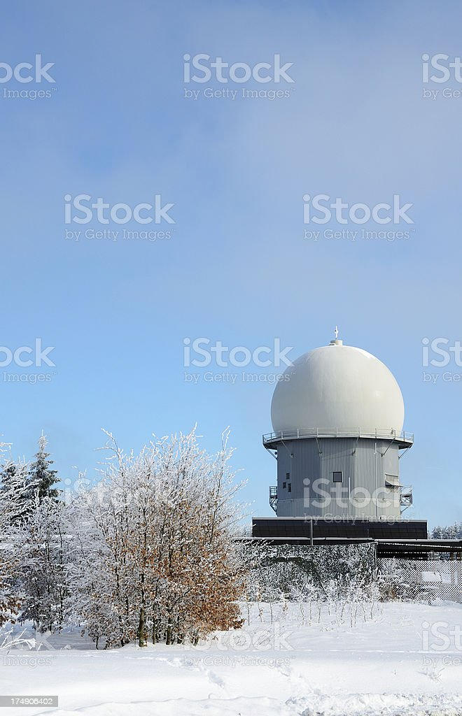 Radar dome on mountain top with frosted trees and snow royalty-free stock photo
