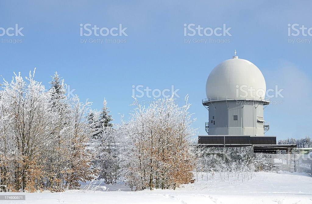 Radar dome on mountain top with frosted trees and snow stock photo