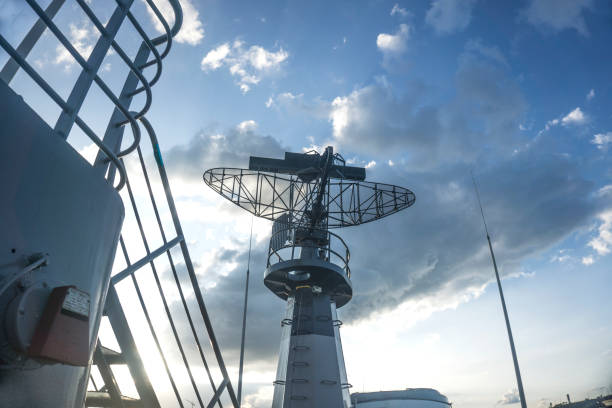 radar on military ship against blue sky - radar foto e immagini stock