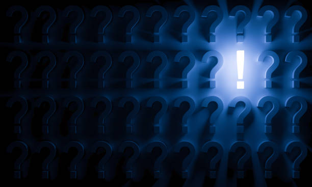 Radiant Exclamation Mark Aligned with Question Marks stock photo