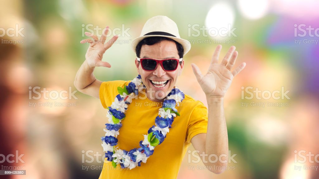 Radiant man celebrates. Man smiling at party. Brazilian celebrating. He's on his feet. Isolated on white background.'n stock photo