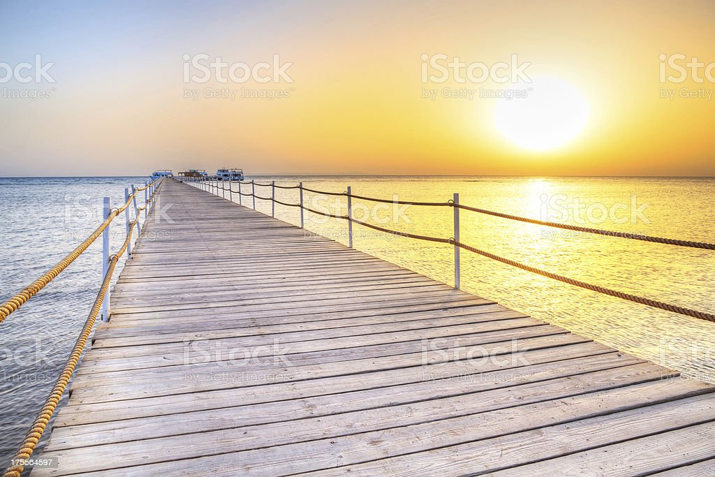 Radiant sunrise at the pier in Hurghada on the Red Sea stock photo