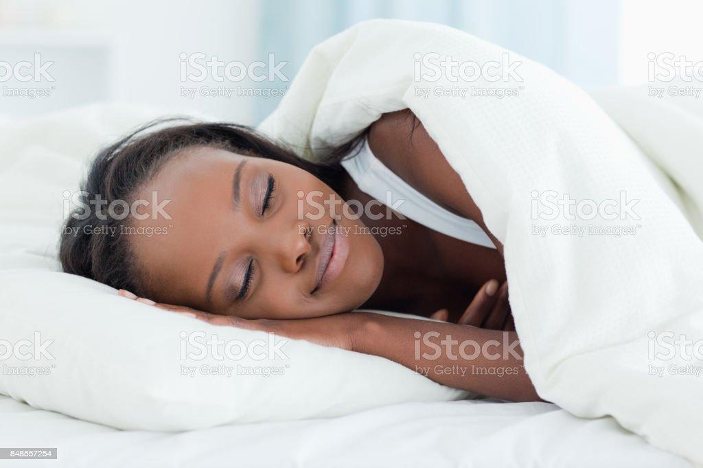 Radiant woman sleeping stock photo