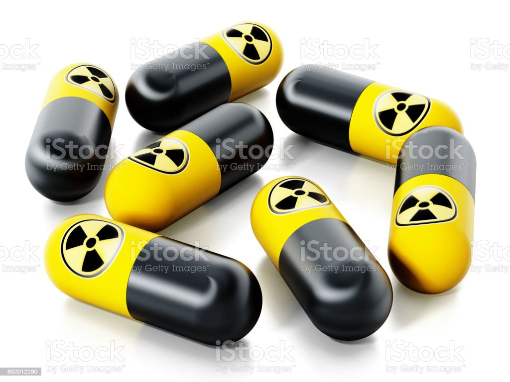 Radiation pills with nuclear energy symbols isolated on white stock photo