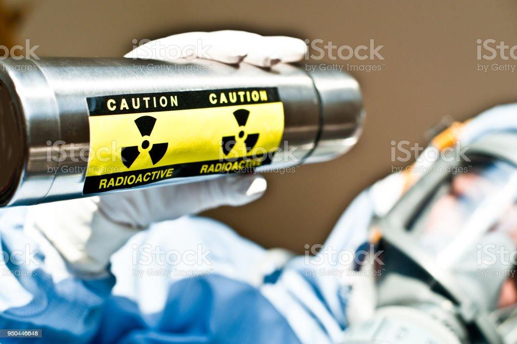 Radiation R&D: Scientist Examines Blue Radioactive Liquid Substance in Beaker