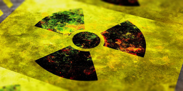 Radiation symbol, yellow background. 3d illustration Radiation symbol on yellow background, view from above. 3d illustration radioactive contamination stock pictures, royalty-free photos & images