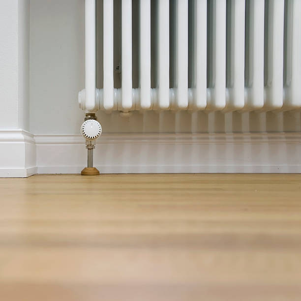 radiator and parquet stock photo