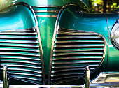 Detail of the Art Deco influenced radiator grille of a postwar American car.