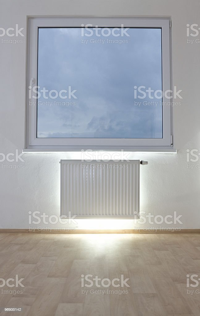 Radiator in unfurnished room royalty-free stock photo