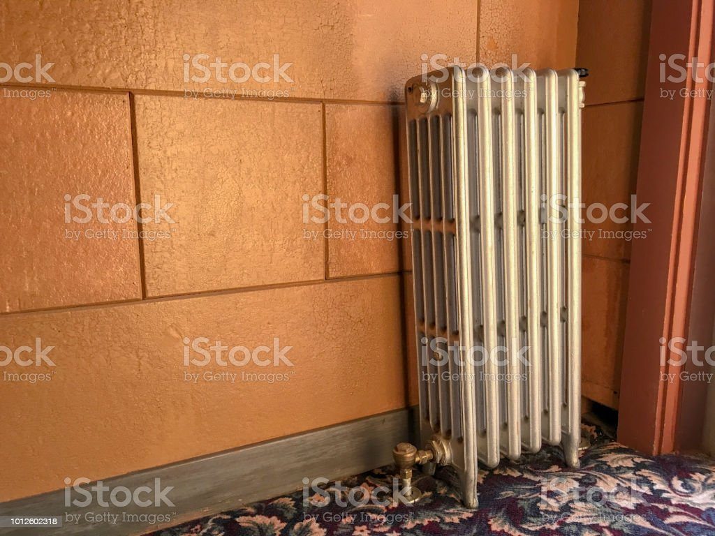 radiator near door for central heating stock photo