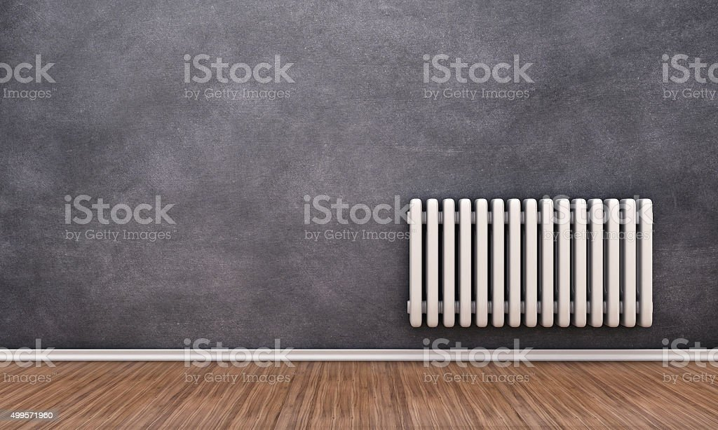 Radiator on a wall stock photo
