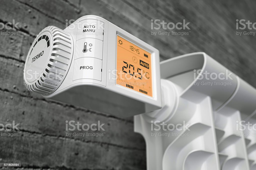 Radiator thermostat controller on heater stock photo