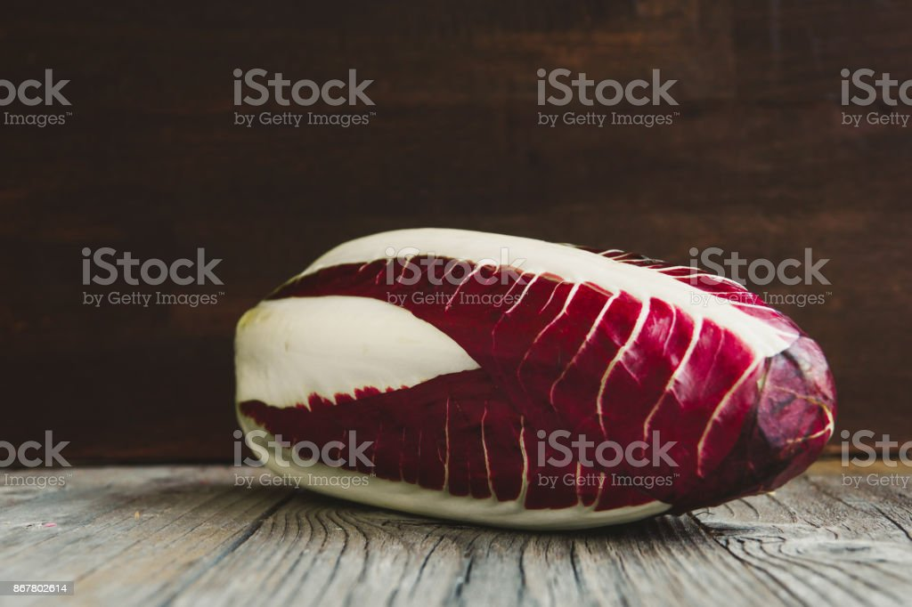 Radicchio, red salad on wooden board stock photo