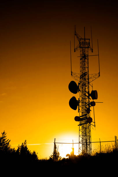 radio and cellular cell broadcast communication towers and receivers - emissione radio televisiva foto e immagini stock
